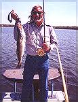 "After only 1 year of tying Scott B. produces georgeous flies, including classic Salmon patterns!! He took this speckled seatrout on his lovely ""Trout Special"" streamer on 3/8/2001. Fishing the flats s"