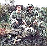 "Mike Clerc says, ""I'm the fat one on the right, my trusty side-kick is Scott Johnson, on the left. The buck was taken at 30 yards, Mathews bow, 2417 XX75 shafts and Muzzy 125gr 3 bladed broadheads. Th"