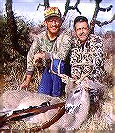 "Guide Duwane Adams (L)and hunter Tony Mandile with a Coues deer buck killed in Sonora, Mexico. The buck had a 16.5"" spread and scored just over 100 B&C points. MEXICO COUES DEERTony Mandile"