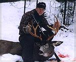 This is a BC muley I shot a couple years back. He''s no great shakes but I think his antler color sets him apart. I shot him out of his bed in the heavy timber at about 20 yards.old yellerjoebuck