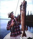 Joe Reynolds with a nice pike caught on a popping bug at Lake Waskiawaccca in northern Manitoba.