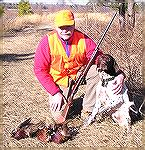 "Me and my son's dog ""Cody"" after a pheasant hunt in early 2005. Note the old Remington Wingmaster. It dropped them just as clean as any of the new wizbang magnums."