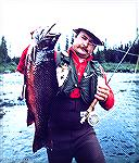 Angler with an eight-pound trophy brook trout caught in the Little Minipi watershed area of Labrador.